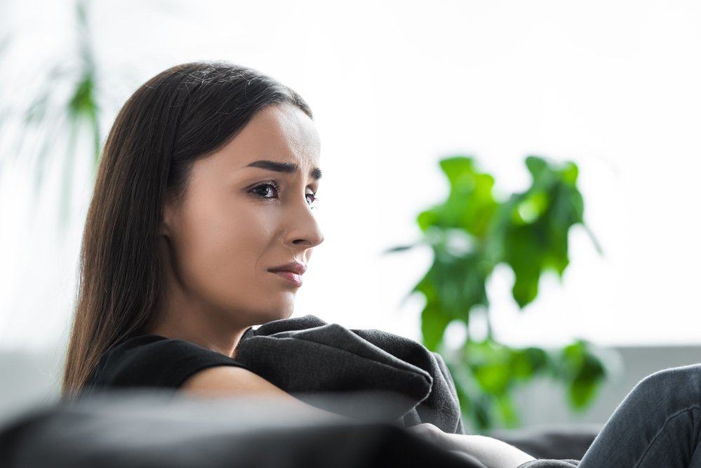 Woman sitting down suffering from depression