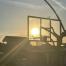 basketball hoop with sun setting